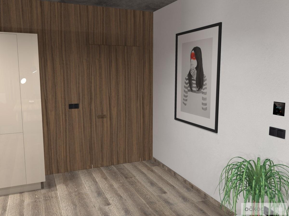 I protější stěna, čili za kuchyní, je obložená ořechem